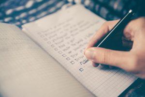hand written check list in a notebook